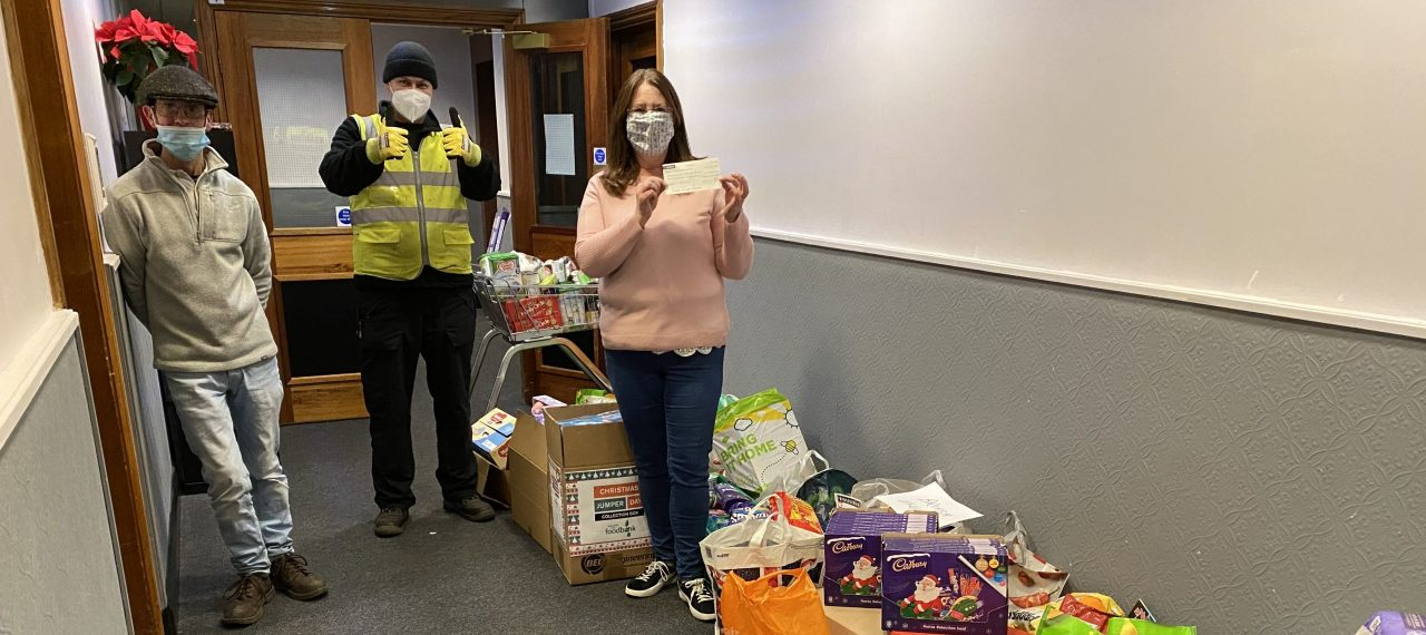 BEL Engineering employees donate to local foodbanks